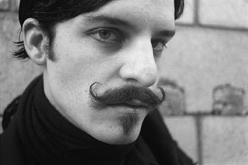 The eyes and 'stache of a poet. A strange, strange poet.